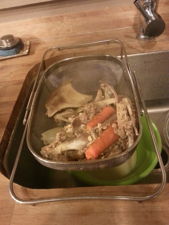 Strain the stock and discard bones and veggies.