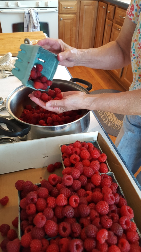 grandma raspberry jam homemade pouring berries into pot oknamaste